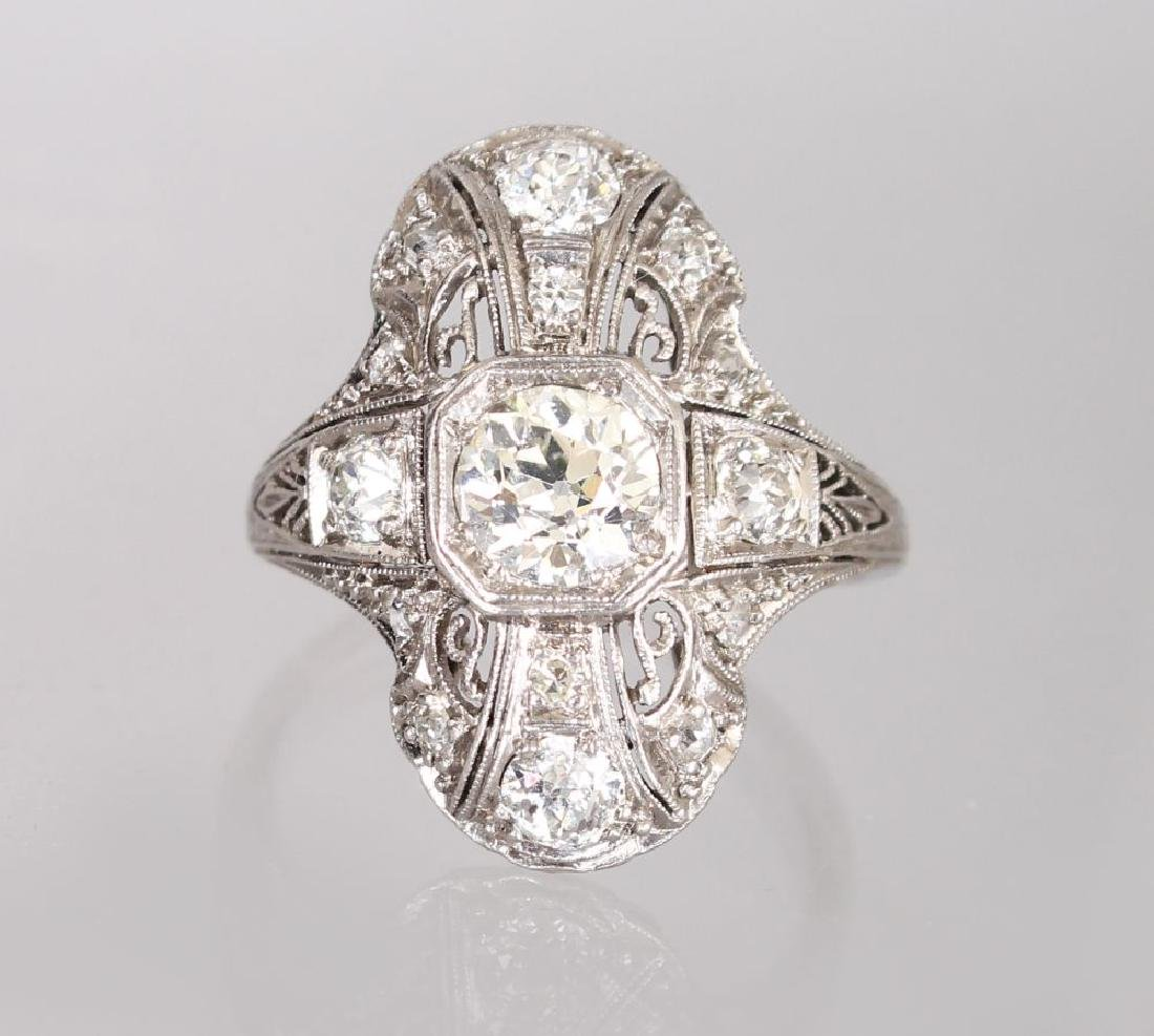 A PLATINUM SET IMPRESSIVE ART DECO DIAMOND RING with