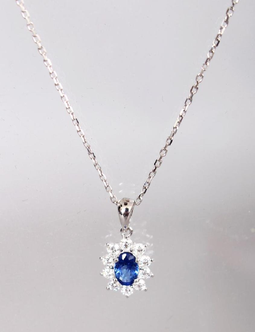 AN 18CT WHITE GOLD, SAPPHIRE AND DIAMOND DAISY STYLE