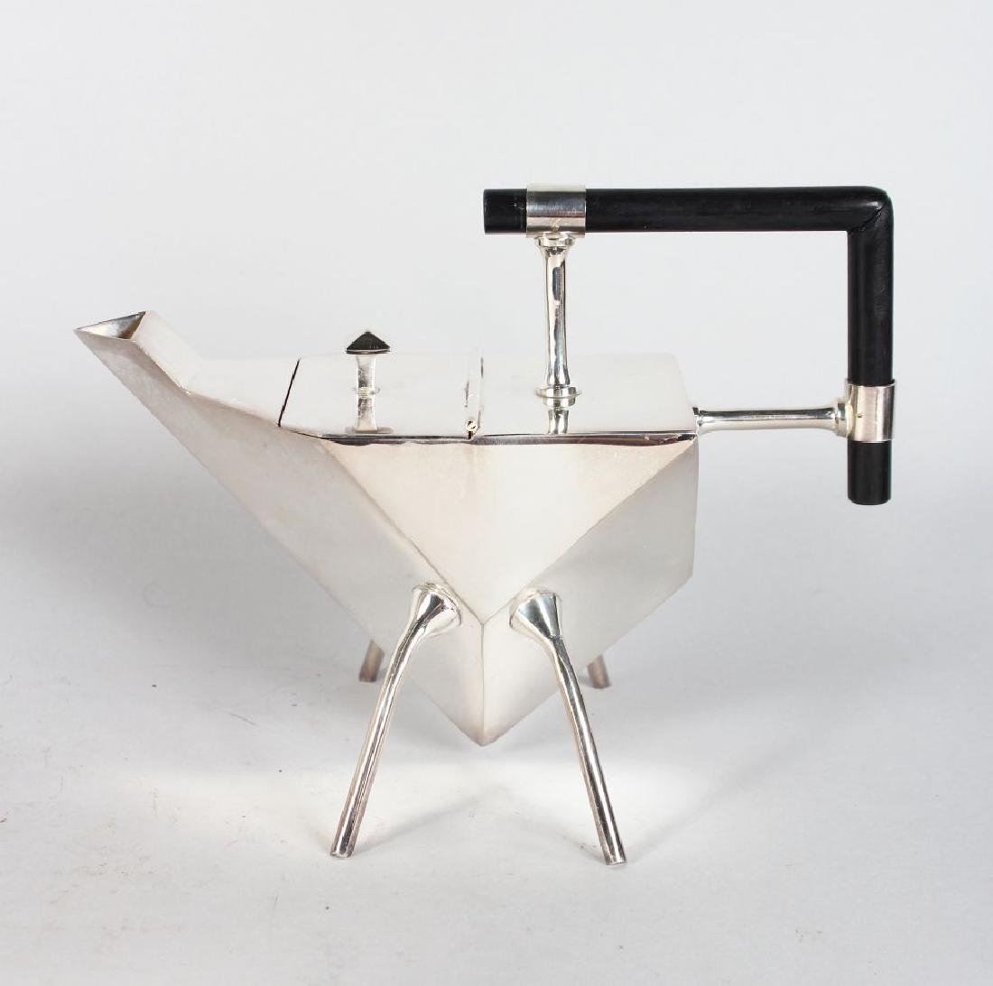 A CHRISTOPHER STYLE HEXAGONAL TEAPOT, with ebony handle