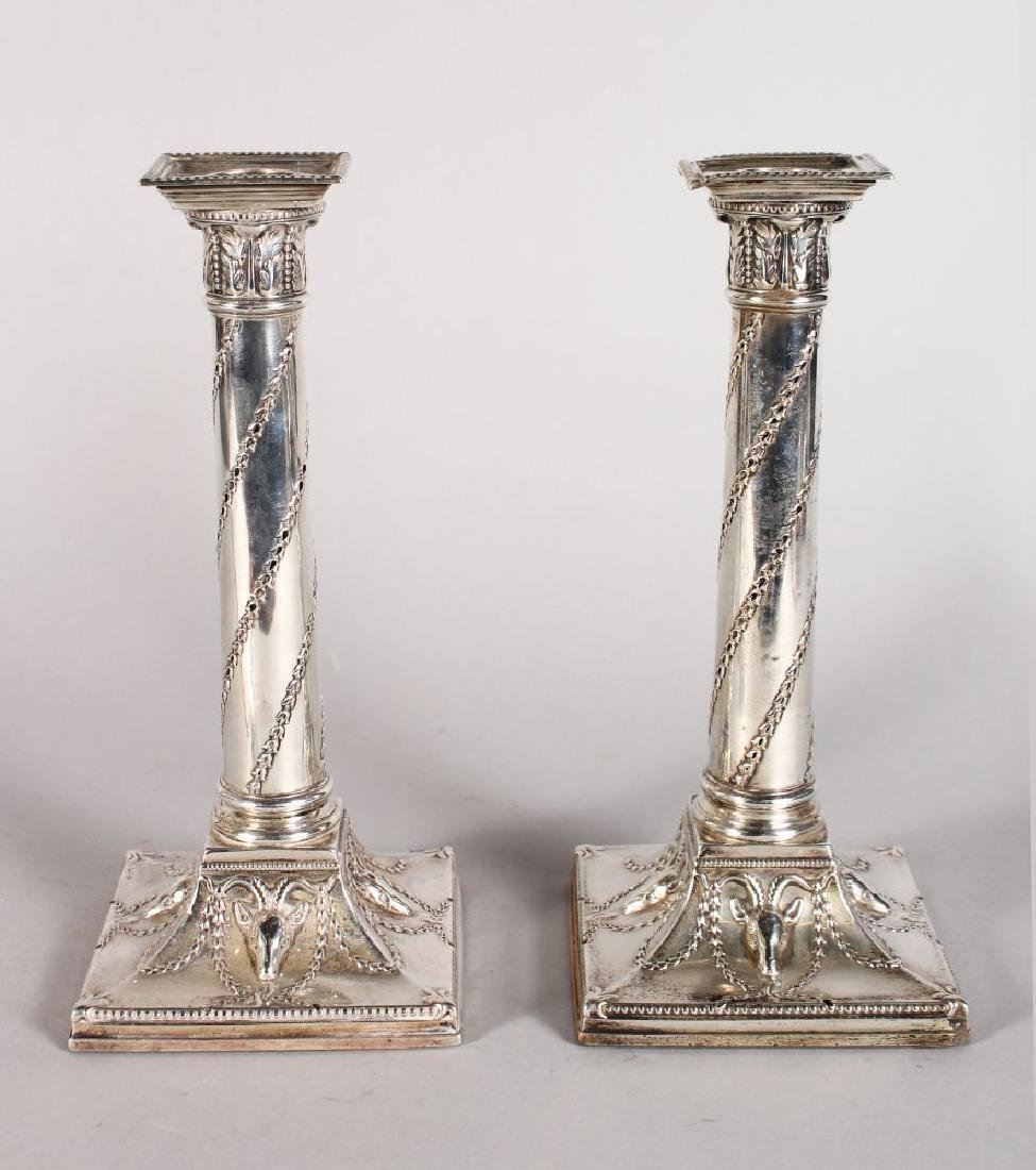 A PAIR OF CLASSICAL SILVER CANDLE STICKS WITH BEAD EDGE