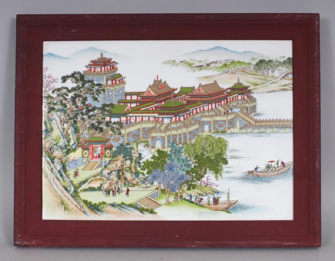 A CHINESE WOOD FRAMED PORCELAIN PLAQUE, depicting a