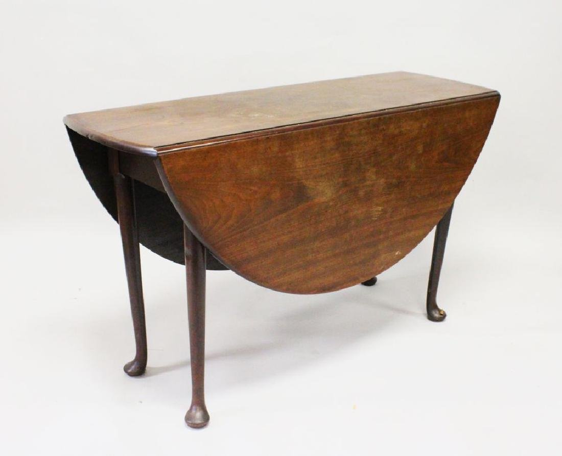 A GEORGE III MAHOGANY OVAL DROP LEAF DINING TABLE, with