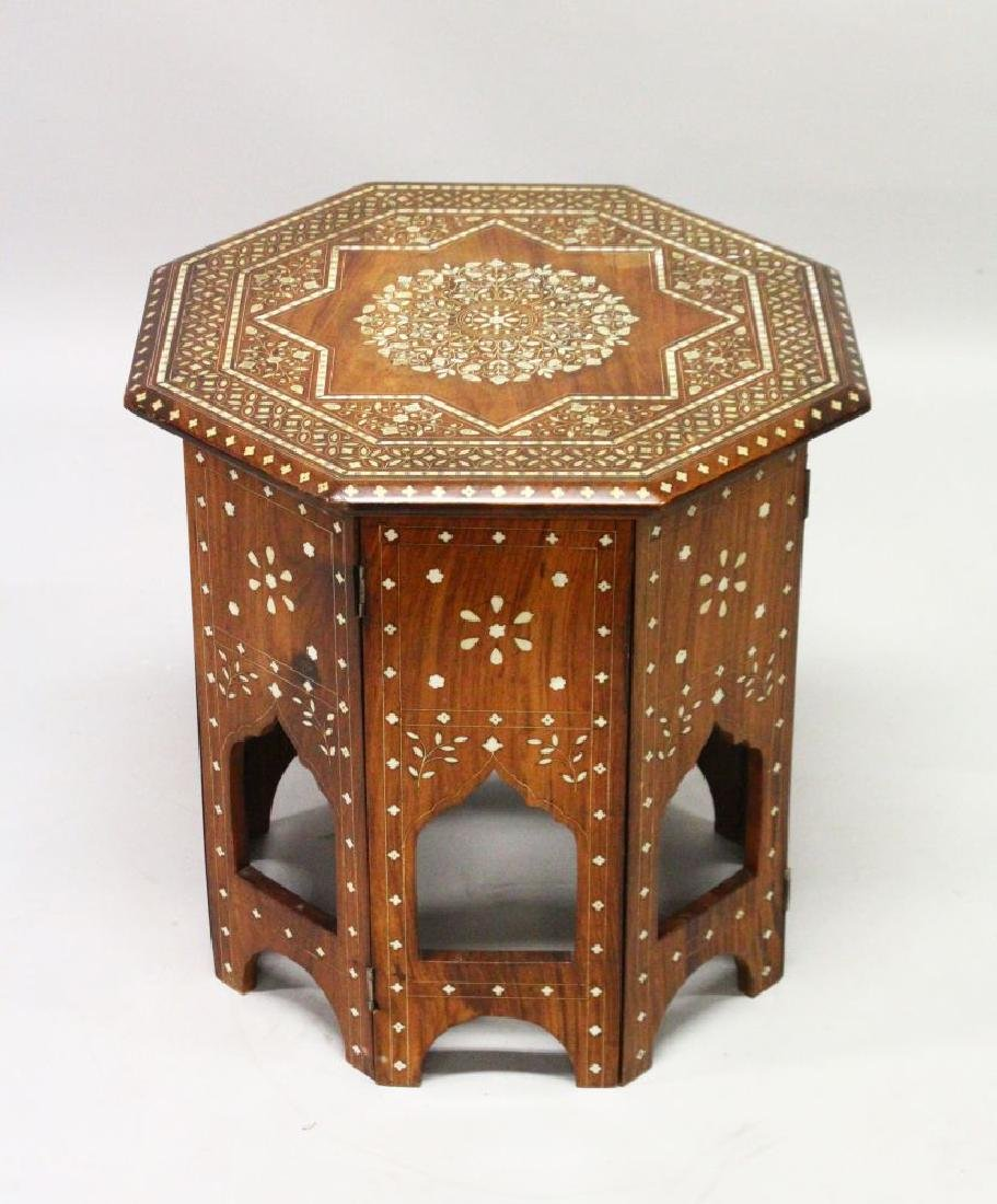 AN INDIAN OCTAGONAL SHAPED FOLDING TABLE, CIRCA 1900,