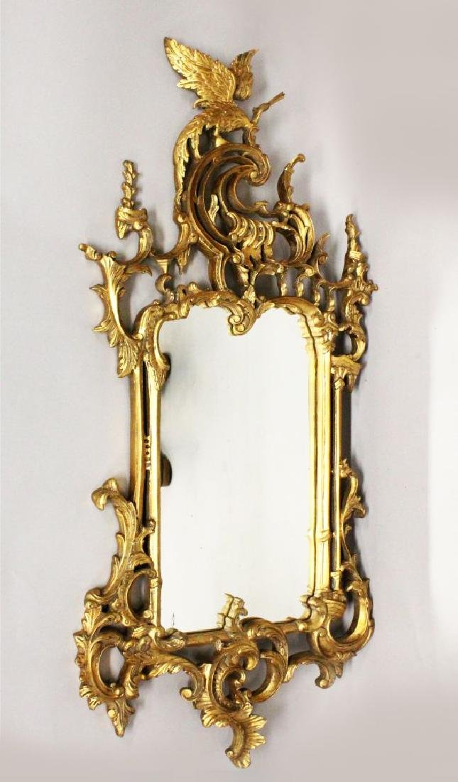 A CHINESE CHIPPENDALE STYLE GILT FRAMED MIRROR with