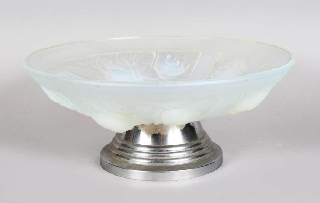 A JULIEN OPALESCENT CIRCULAR GLASS COMPORT, with four