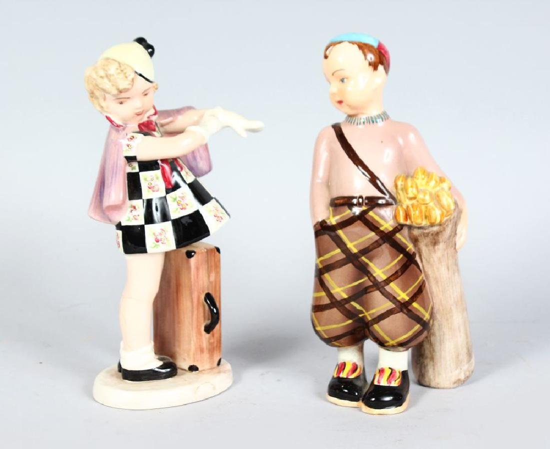A PAIR OF GOLDSCHEIDER FIGURES, BOY WITH GOLF CLUBS AND