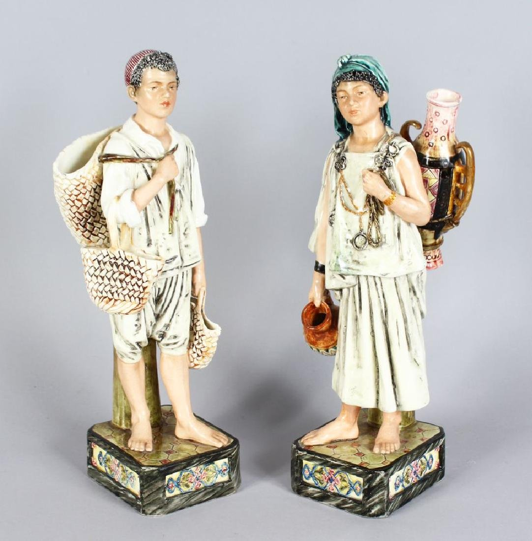 A PAIR OF CONTINENTAL MAJOLICA FIGURES, YOUNG BOY AND