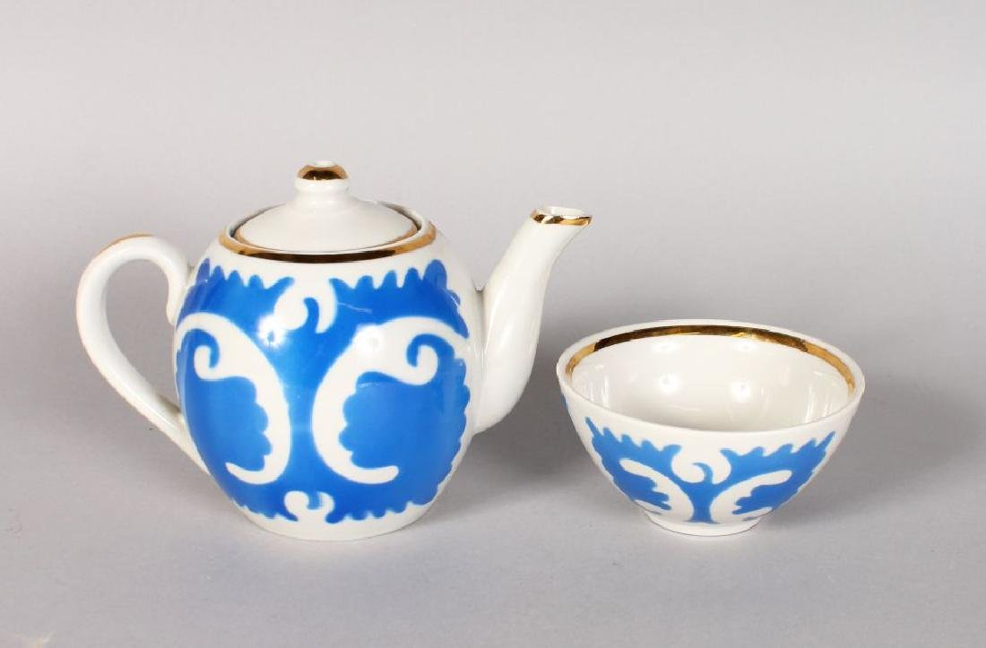 A RUSSIAN PORCELAIN TEAPOT and SLOP BOWL with blue