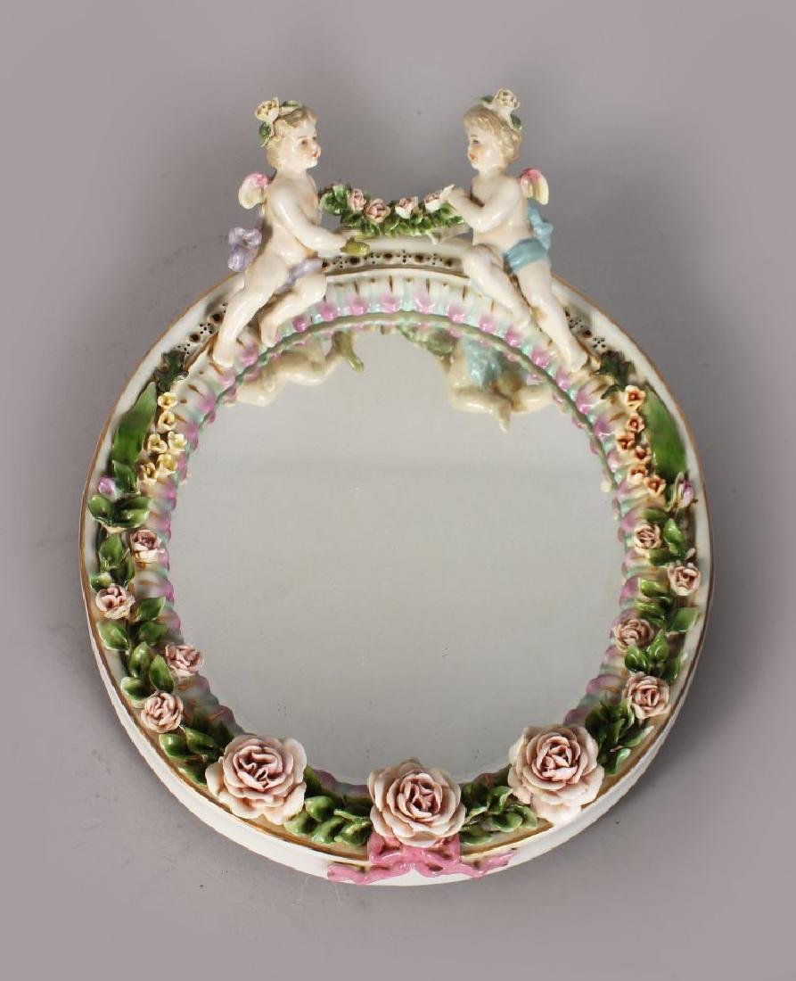 A MEISSEN STYLE PORCELAIN MIRROR, with a pair of