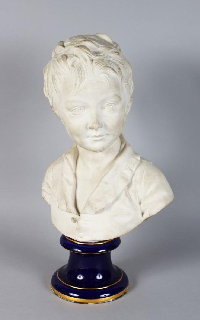 AFTER HOUDON.  A WHITE PORCELAIN BUST OF A YOUNG BOY,