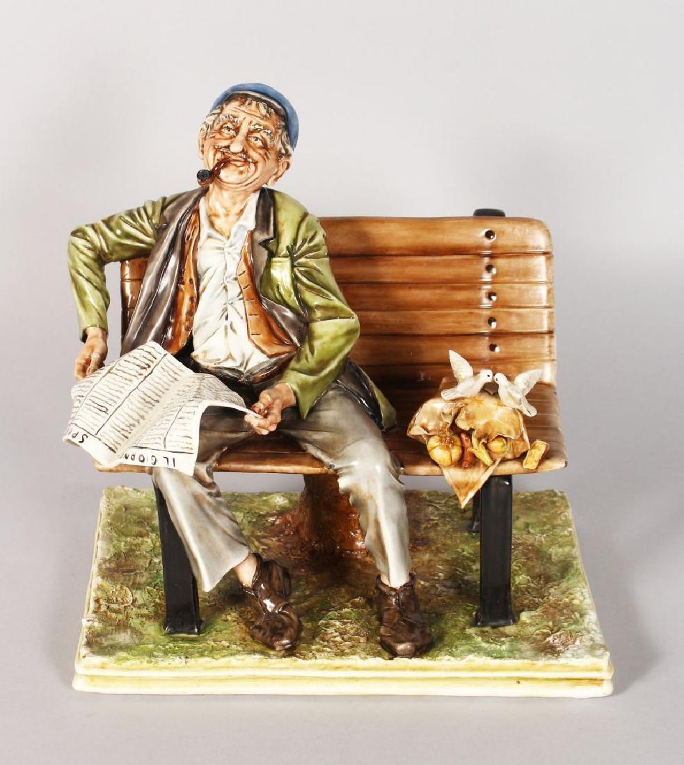 A CAPODIMONTE PORCELAIN GROUP, a man on a bench reading