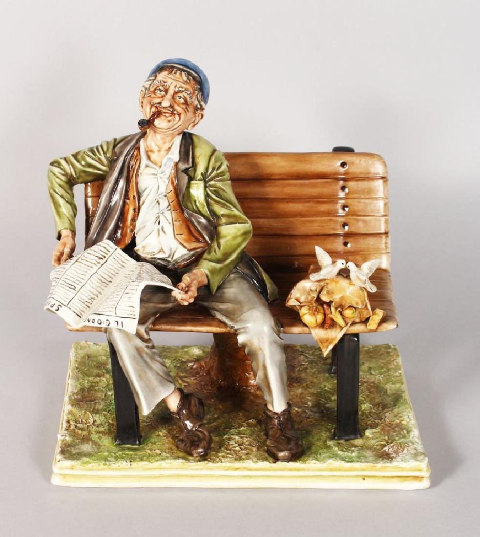 A CAPODIMONTE PORCELAIN GROUP, a man on a bench reading