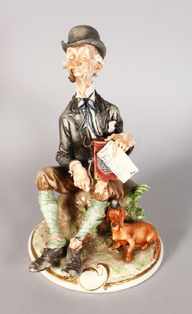 A CAPODIMONTE PORCELAIN GROUP, an old man with wind up