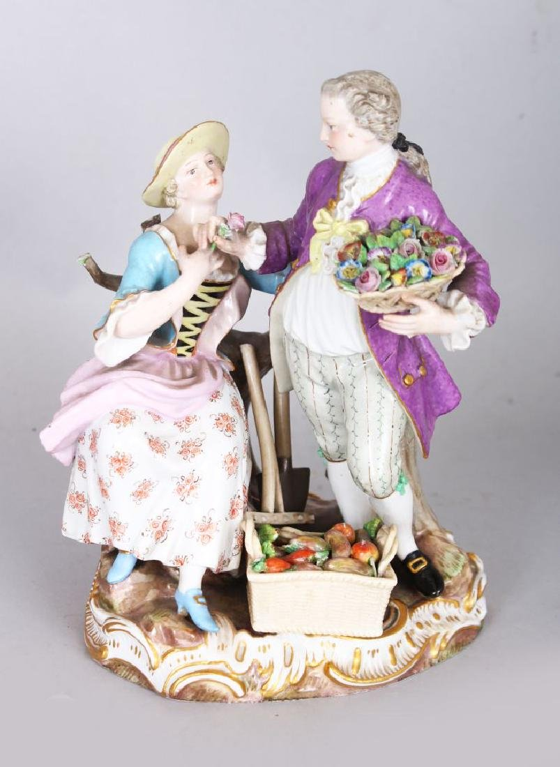 A GOOD 19TH CENTURY MEISSEN GROUP OF A GALLANT carrying