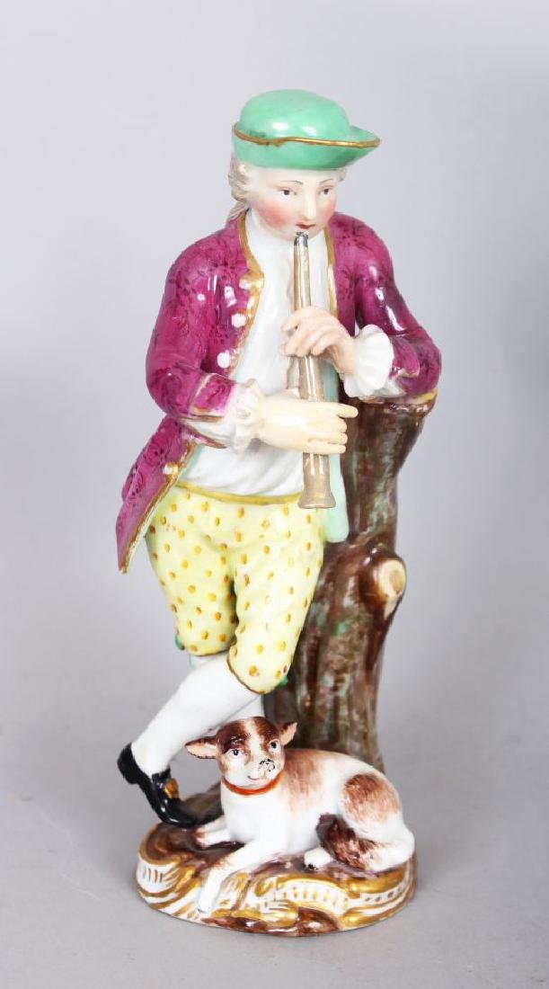 A SMALL 19TH CENTURY MEISSEN BOY PLAYING A PIPE, a dog