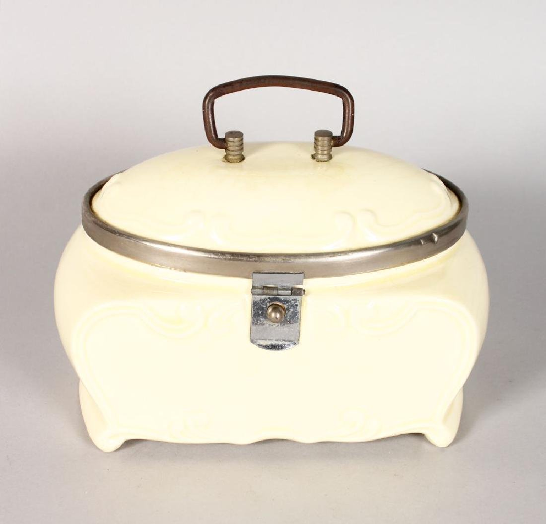 AN ART DECO DESIGN PORCELAIN SANDWICH BOX, cream.  7ins