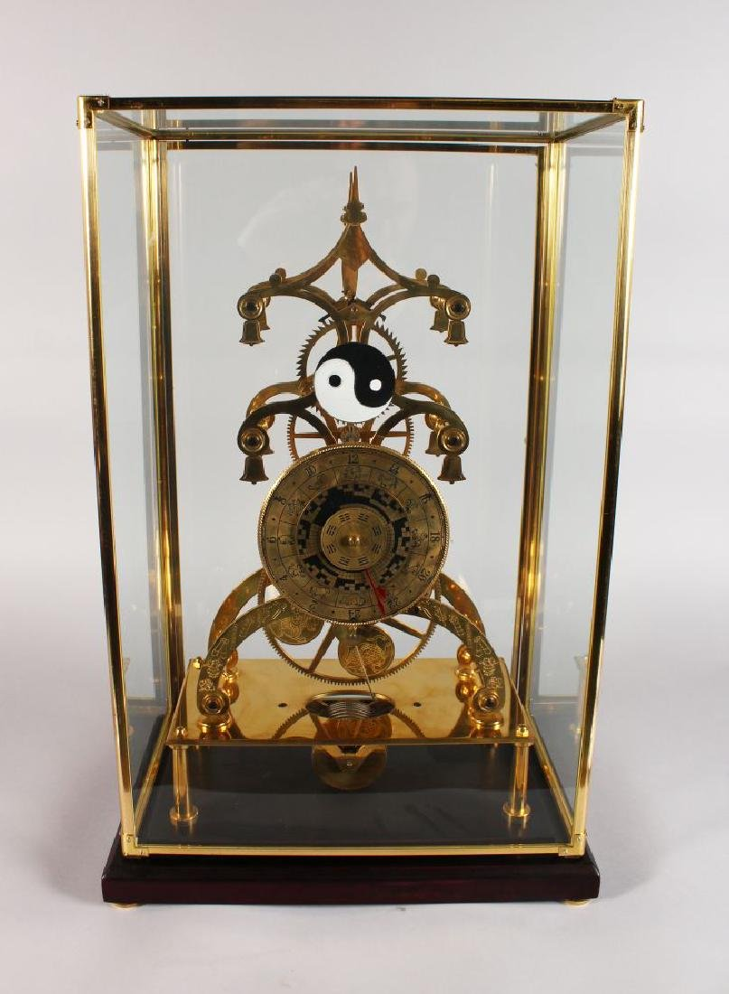 A LARGE SKELETON CLOCK, the brass dial engraved with