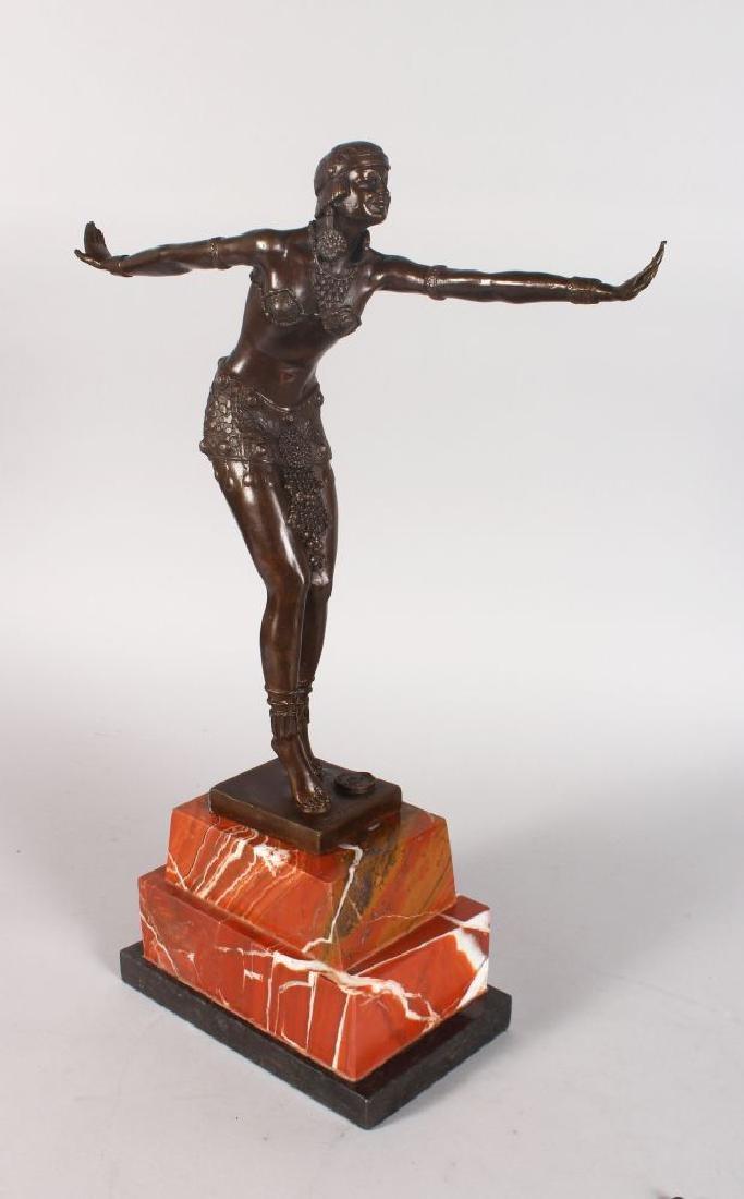 AN ART DECO STYLE BRONZE FIGURE OF A DANCER, arms