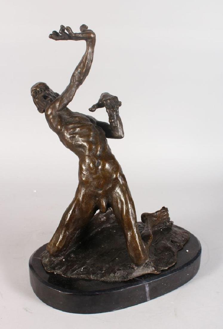 AN UNUSUAL ABSTRACT BRONZE OF A NAKED MALE FIGURE, in a