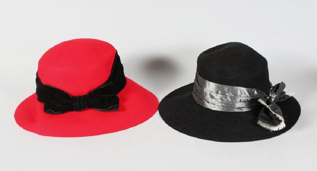 A RED YVES SAINT LAURENT HAT, size 57, and A BLACK HAT