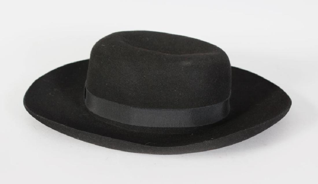A GIORGIO ARMANI BLACK HAT.