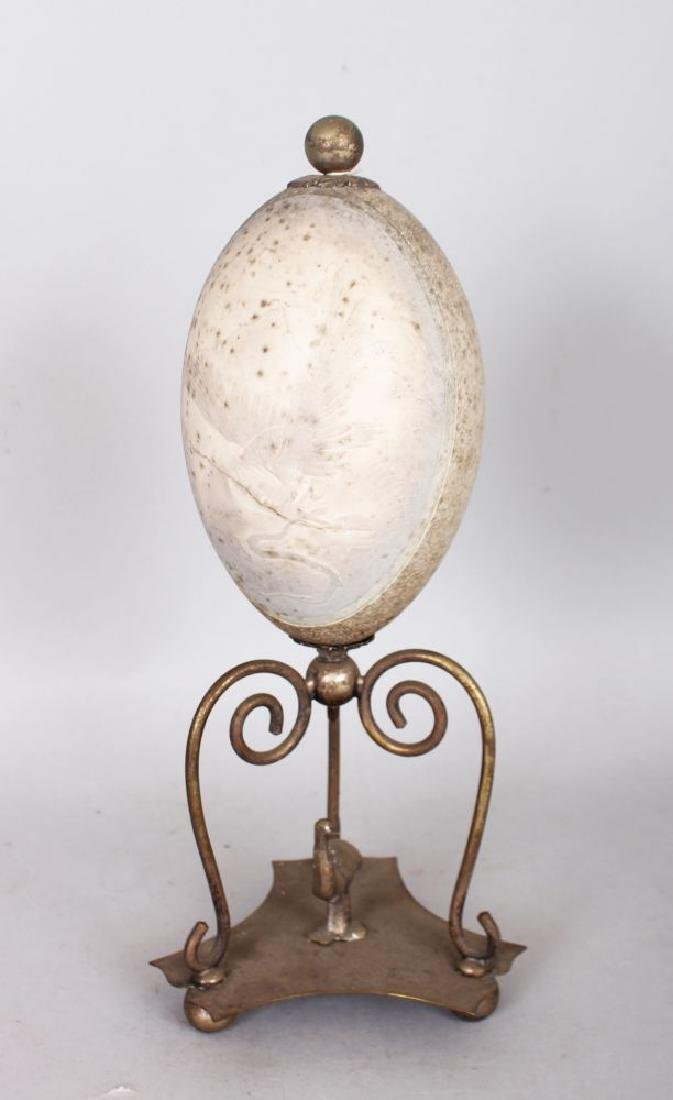 AN AUSTRALIAN MOUNTED EMU EGG, on a plated stand