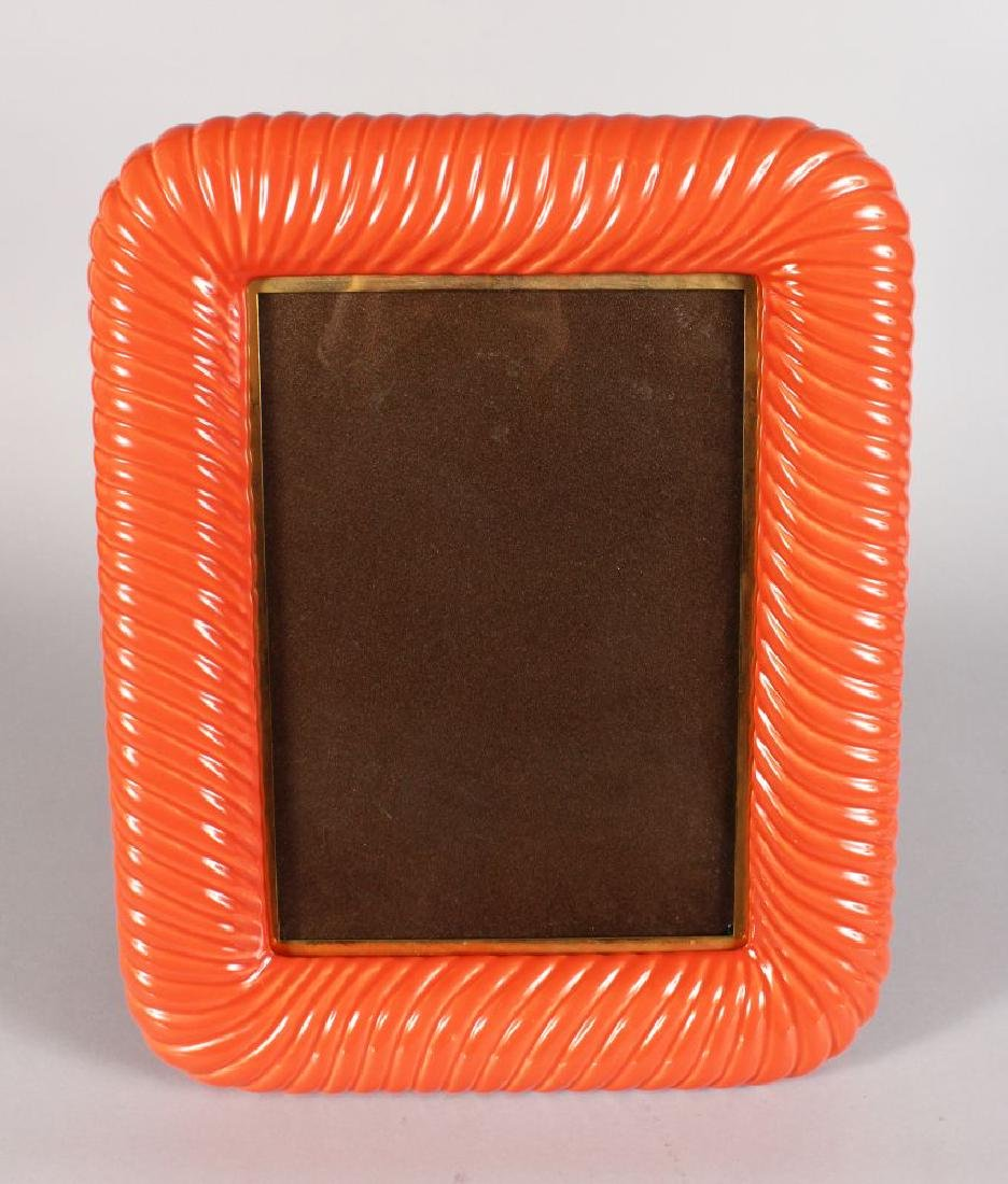 A CORAL COLOURED EASEL PICTURE FRAME. 16ins x 13ins.