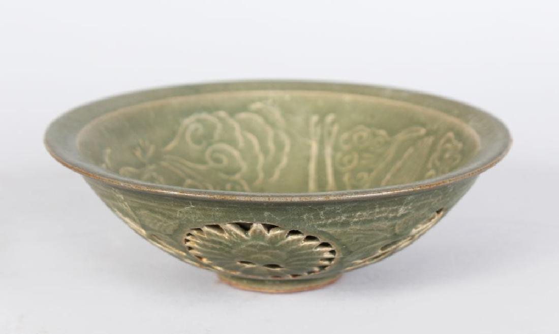 A CHINESE CELLADON BOWL, with incised and pierced