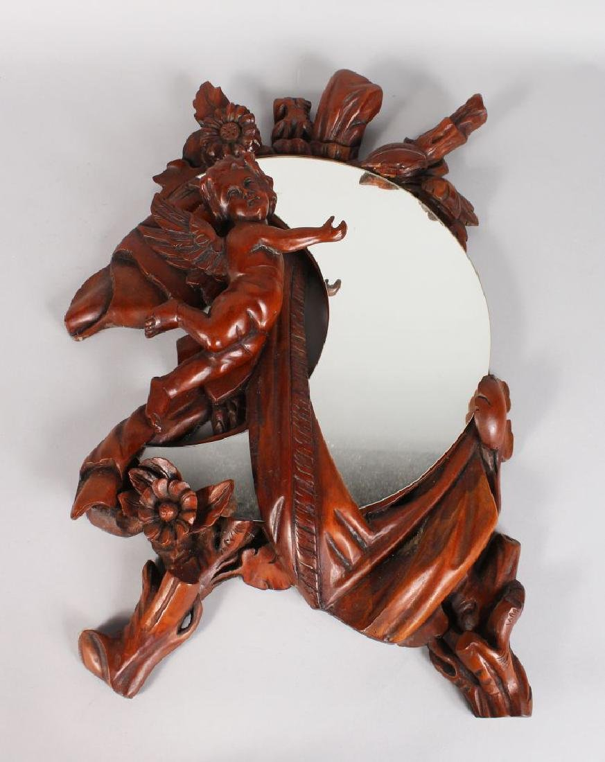 A GOOD CARVED WOOD CHERUB MIRROR with crescent shaped