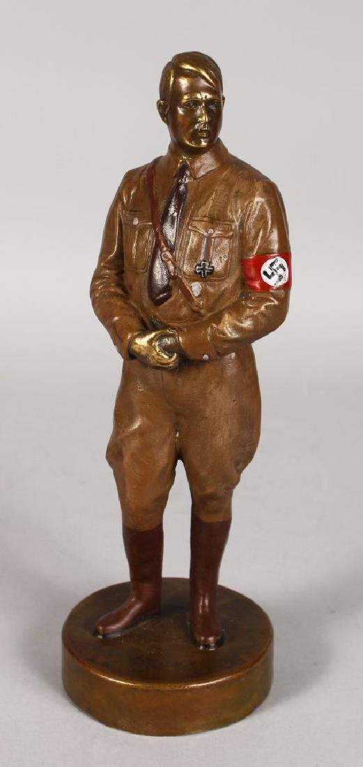 A STANDING BRONZE OF HITLER, on a circular base.  11ins