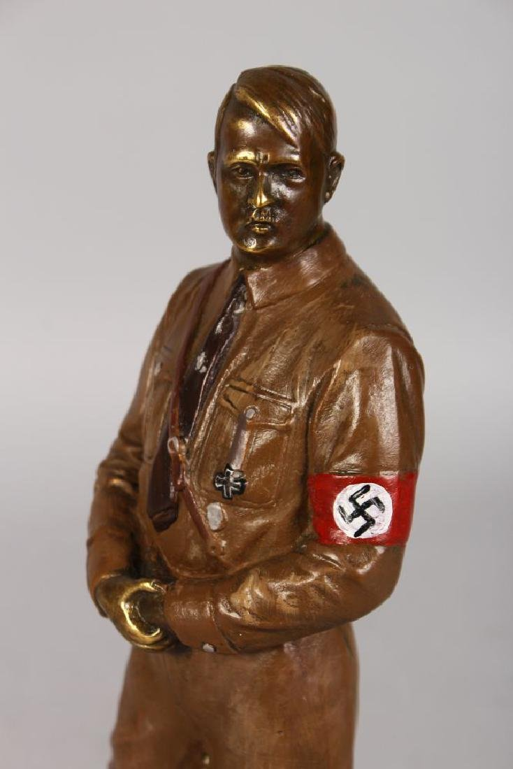 A STANDING BRONZE OF HITLER, on a circular base.  11ins - 2