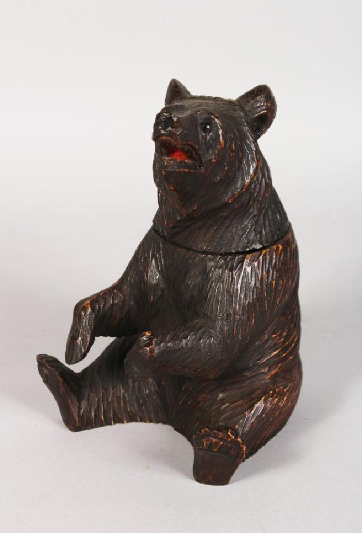 A BLACK FOREST CARVED WOOD SEATED BEAR TOBACCO JAR with