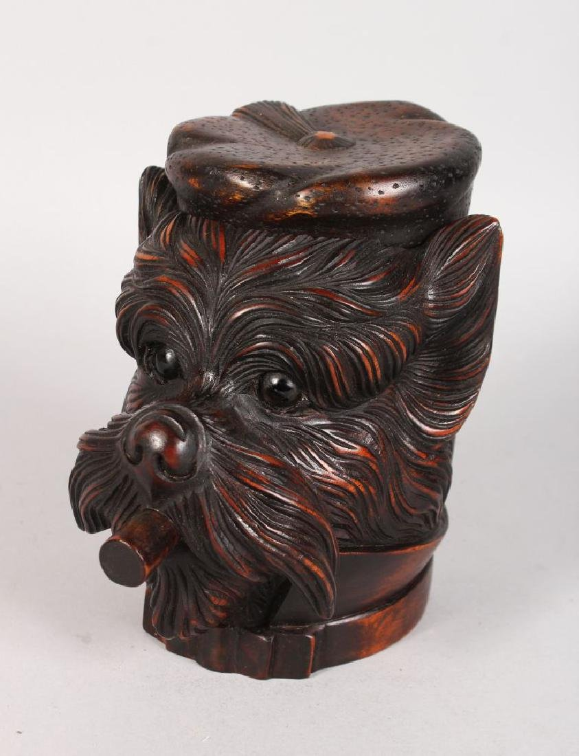 A BLACK FOREST CARVED WOOD DOG'S HEAD with hinged top
