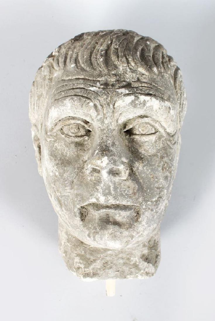 AN EARLY CARVED MARBLE BUST OF A MAN (Possibly Roman).