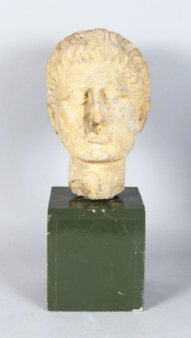 AN EARLY CARVED MARBLE BUST OF A MAN (Possibly Roman),