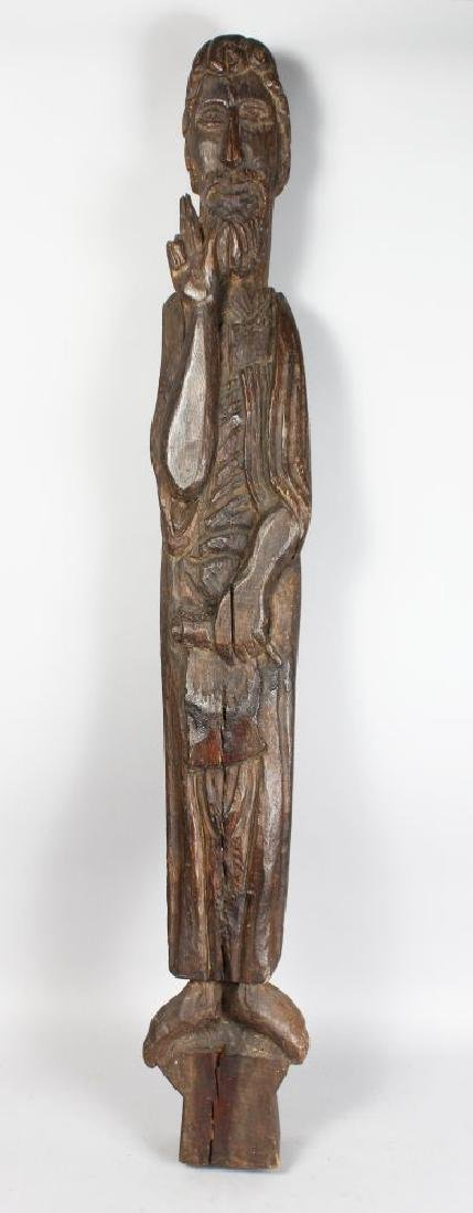 A LARGE EARLY CARVED WOOD SLENDER FIGURE OF A SAINT.