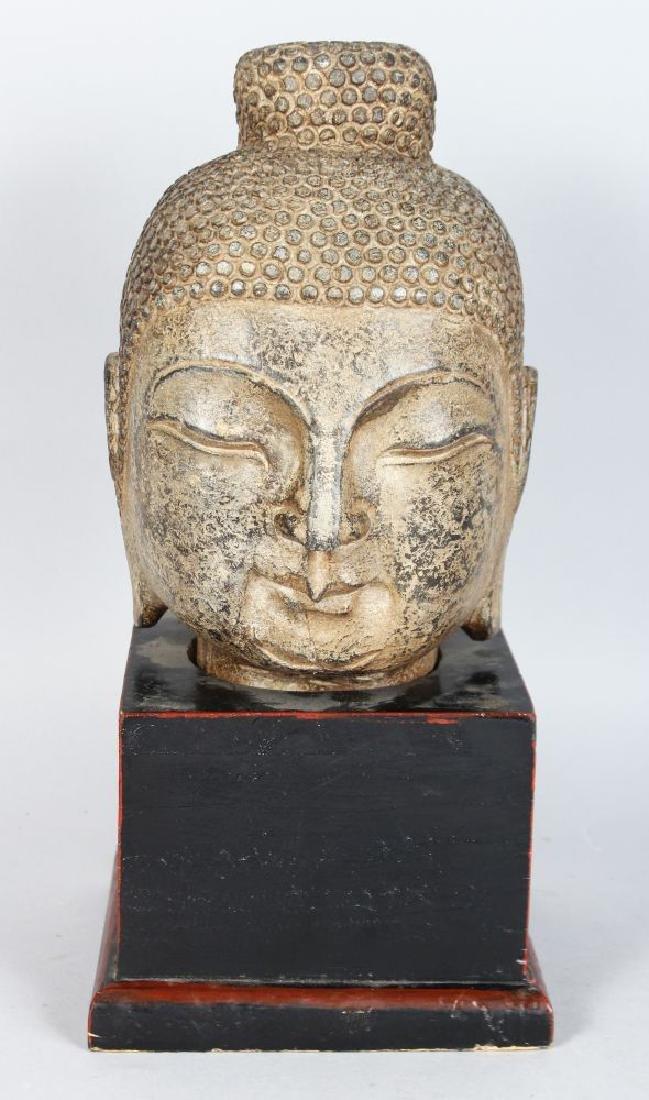A CAST METAL HEAD OF A BUDDHA, 20TH CENTURY, on a