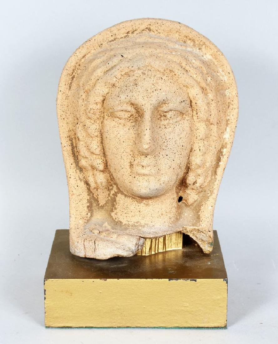A TERRACOTTA BUST OF A YOUNG LADY, with her head in a