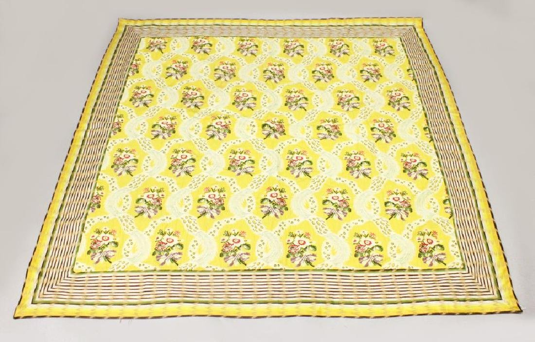 A FLORAL EMBROIDERED WALL HANGING, yellow ground with