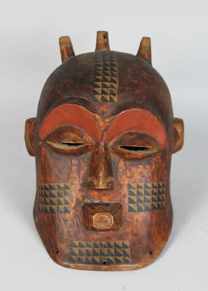 AN AFRICAN CARVED BIOMBO STYLE HELMET MASK with Horns,