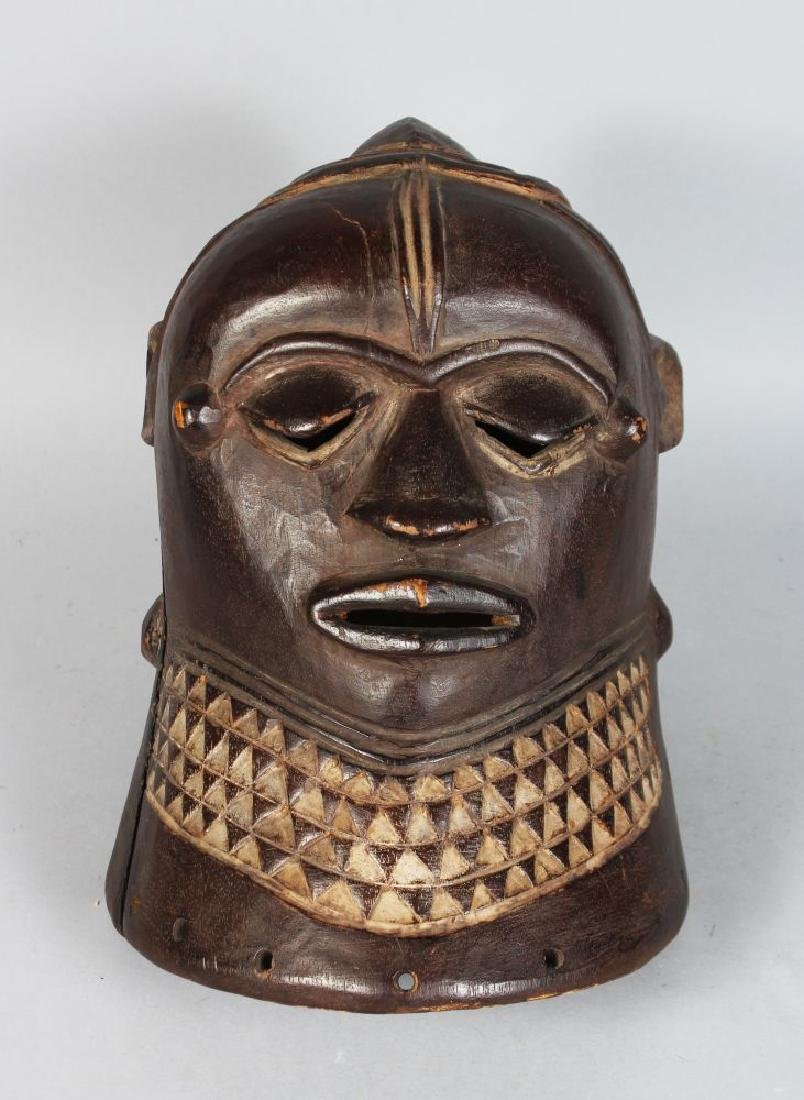 AN AFRICAN CARVED WOOD HELMET MASK, POSSIBLY IGALA,