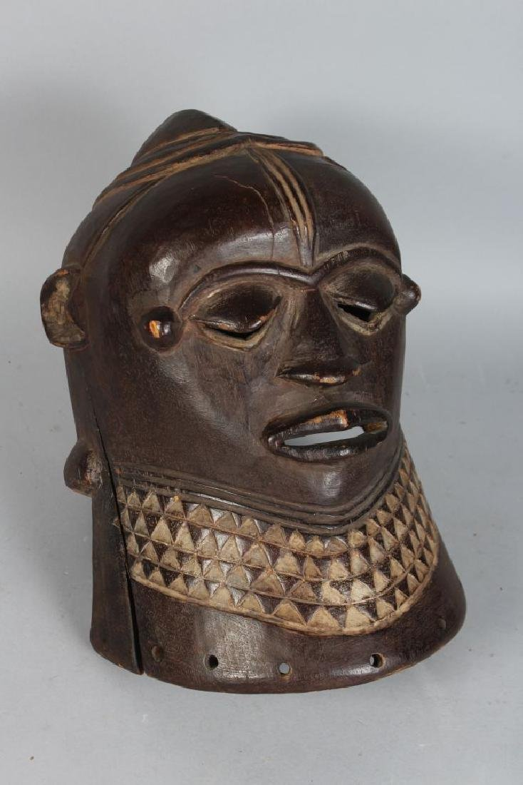 AN AFRICAN CARVED WOOD HELMET MASK, POSSIBLY IGALA, - 2