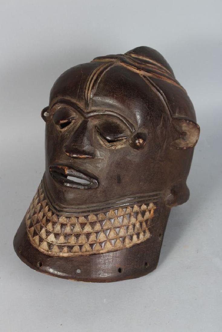 AN AFRICAN CARVED WOOD HELMET MASK, POSSIBLY IGALA, - 3