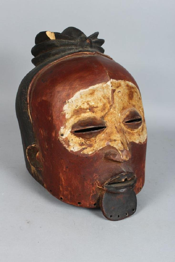 AN ASIAN POLYCHROME CARVED WOODEN HELMET MASK,  finely - 2