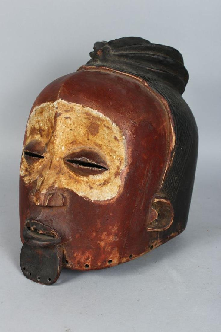 AN ASIAN POLYCHROME CARVED WOODEN HELMET MASK,  finely - 3