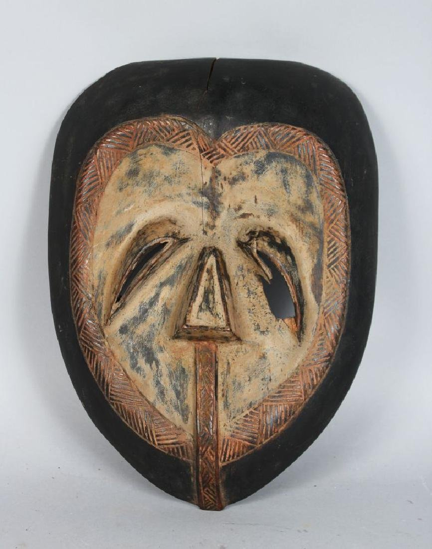 AN AFRICAN CARVED WOOD MASK, TSOGO STYLE, pierced eyes,