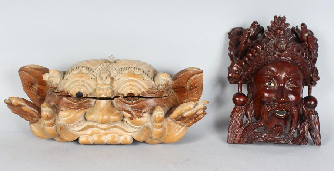 AN INDONESIAN CARVED TUGEH BOMO WOODEN BELL in the form