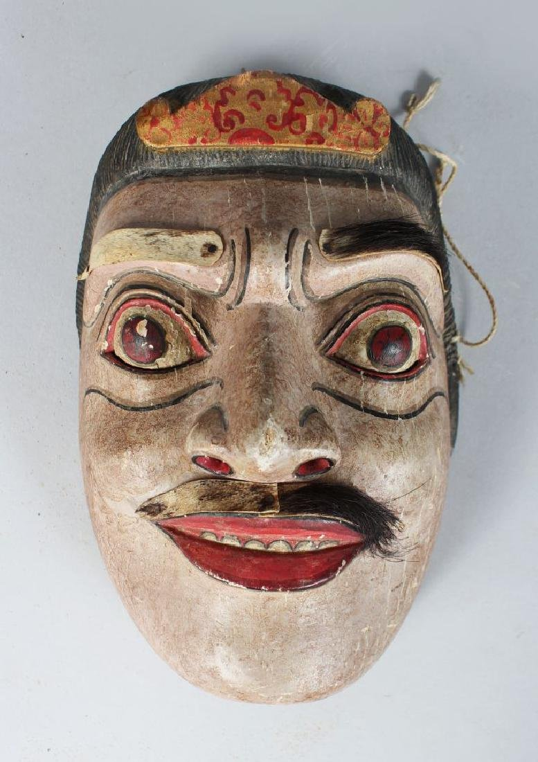 A POLYCHROME CARVED WOODEN DANCE MASK (TOPENG)
