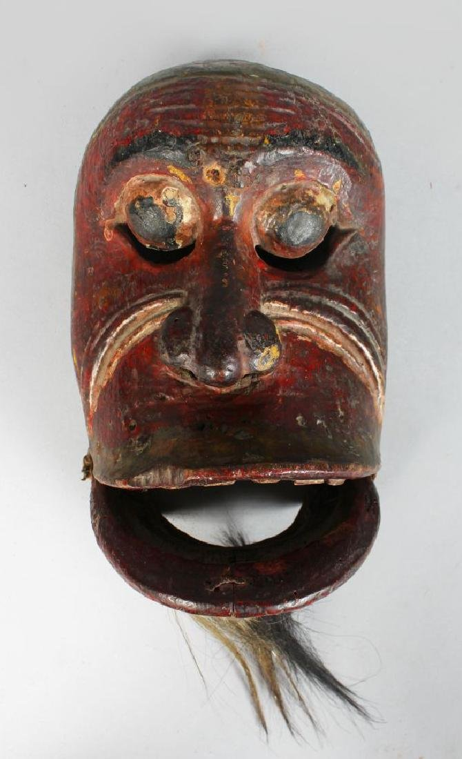 A POLYCHROME CARVED WOODEN DANCE MASK (TOPENG) of Kebo