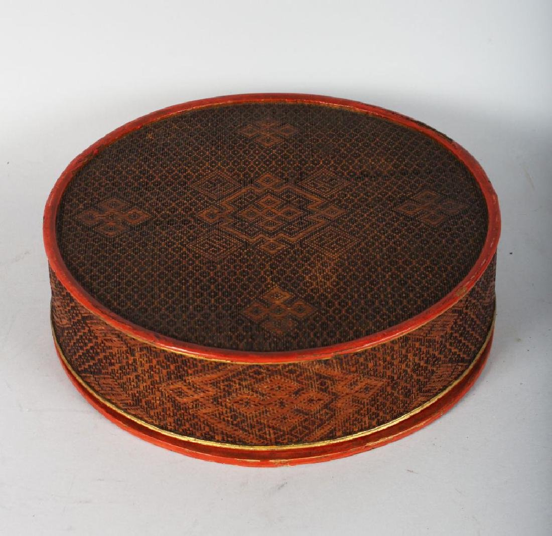 A CIRCULAR RED LACQUER BOX AND COVER. 11ins diameter.